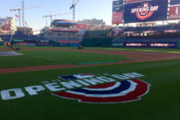 Workers prepare the field at Nationals Park Thursday ahead of the home opener. (WTOP/Nick Iannelli)