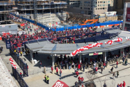 Huge crowds of fans gather at the gates to Nationals Park for opening day in April 2018. (WTOP/Julia Ziegler)