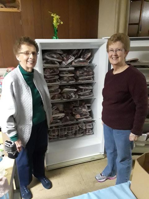 Josephine Willard (left), director of HELP Hotline, and Carol Schorn, secretary of HELP Hotline, with their donated venison. (Courtesy National Park Service)