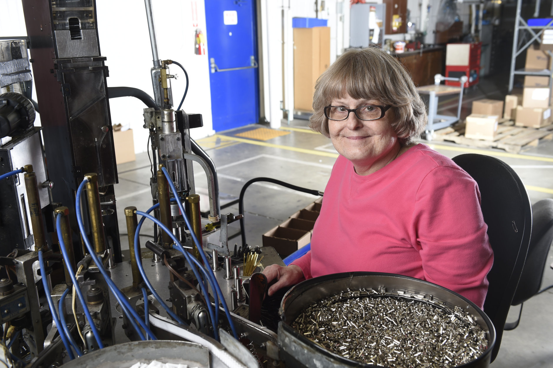 Lynn Larson, a machine operator at Industries of the Blind in Greensboro, North Carolina, manufacturing the SKILCRAFT U.S. Government pen. She has been working for the organization for nearly 40 years. (Courtesy National Indsutries for the Blind)