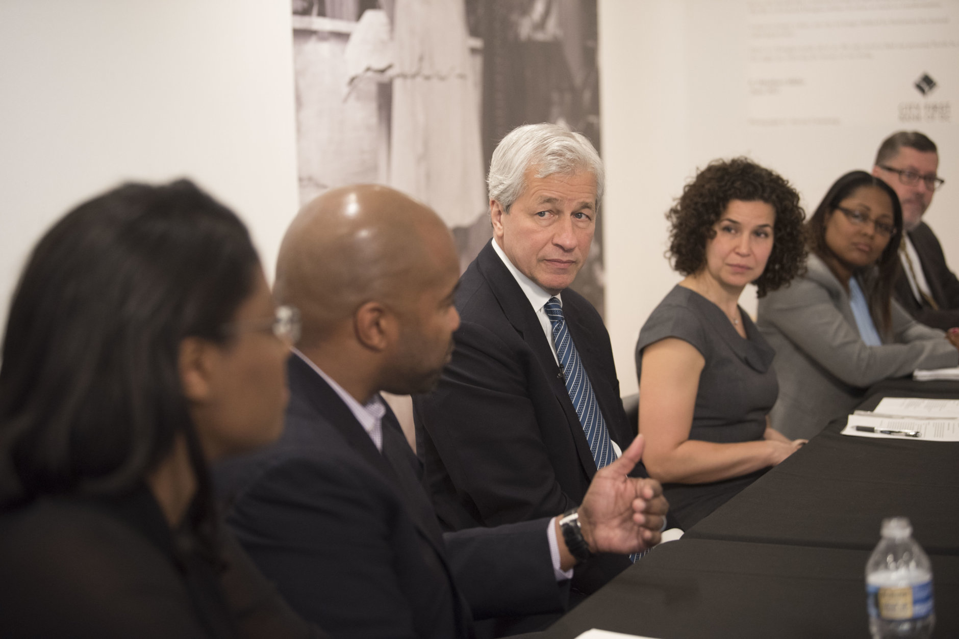 IMAGE DISTRIBUTED FOR JPMORGAN CHASE & CO. - JPMorgan Chase & Co. Chairman and CEO Jamie Dimon, center, takes part in a Community Roundtable/Meet and Greet at the Anacostia Arts Center on Wednesday, April 18, 2018 in Washington. (Kevin Wolf/AP Images for JPMorgan Chase & Co.)