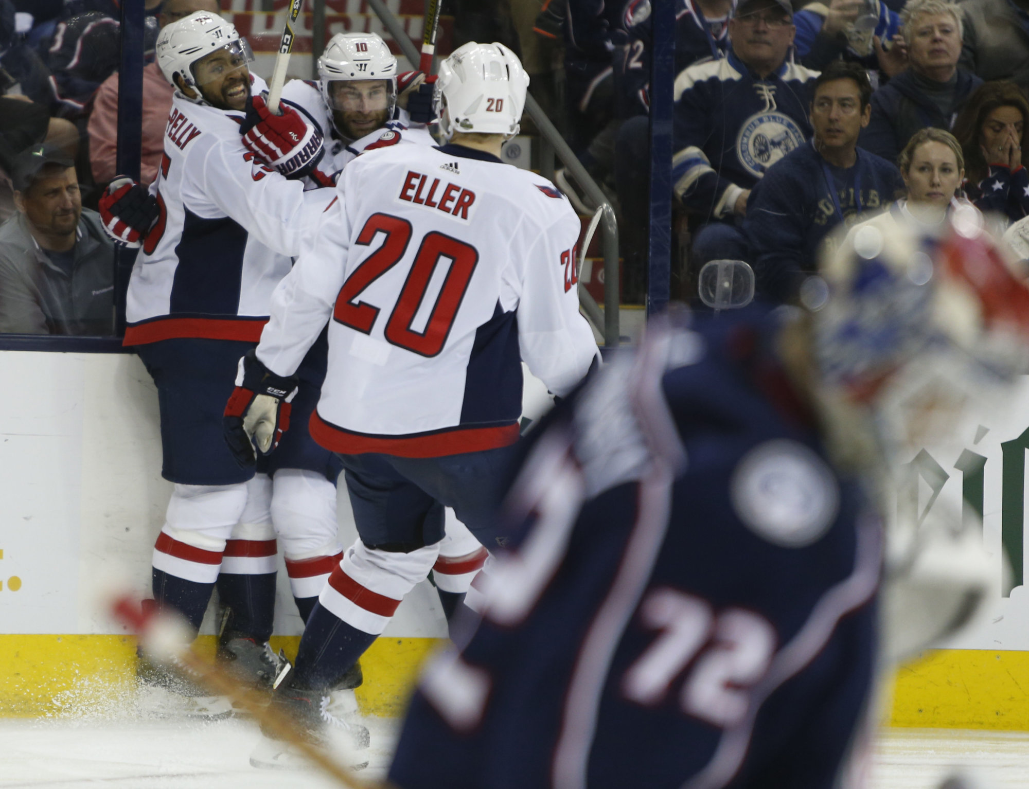 Washington Capitals' Devante Smith-Pelly, left to right, Brett Connolly, and Lars Eller, of Denmark, celebrate their goal against the Columbus Blue Jackets during the third period of Game 6 of an NHL first-round hockey playoff series Monday, April 23, 2018, in Columbus, Ohio. The Capitals defeated the Blue Jackets 6-3. (AP Photo/Jay LaPrete)