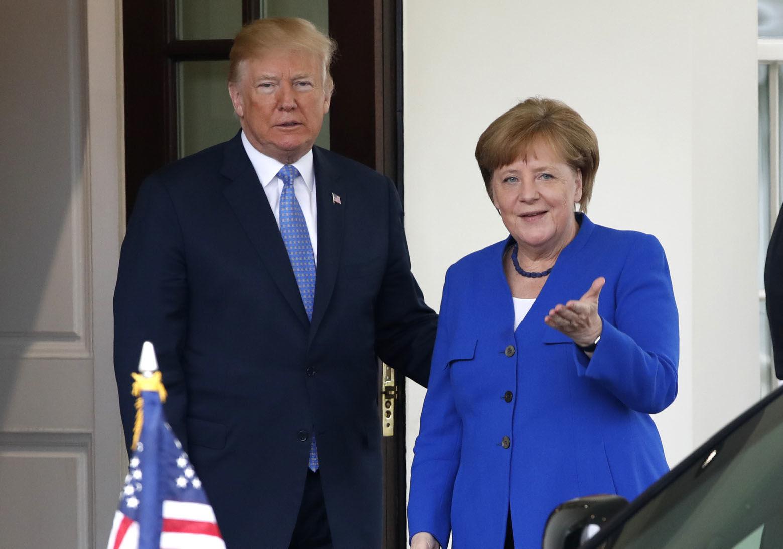 President Donald Trump greets German Chancellor Angela Merkel, Friday April 27, 2018, at the White House in Washington. (AP Photo/Jacquelyn Martin)