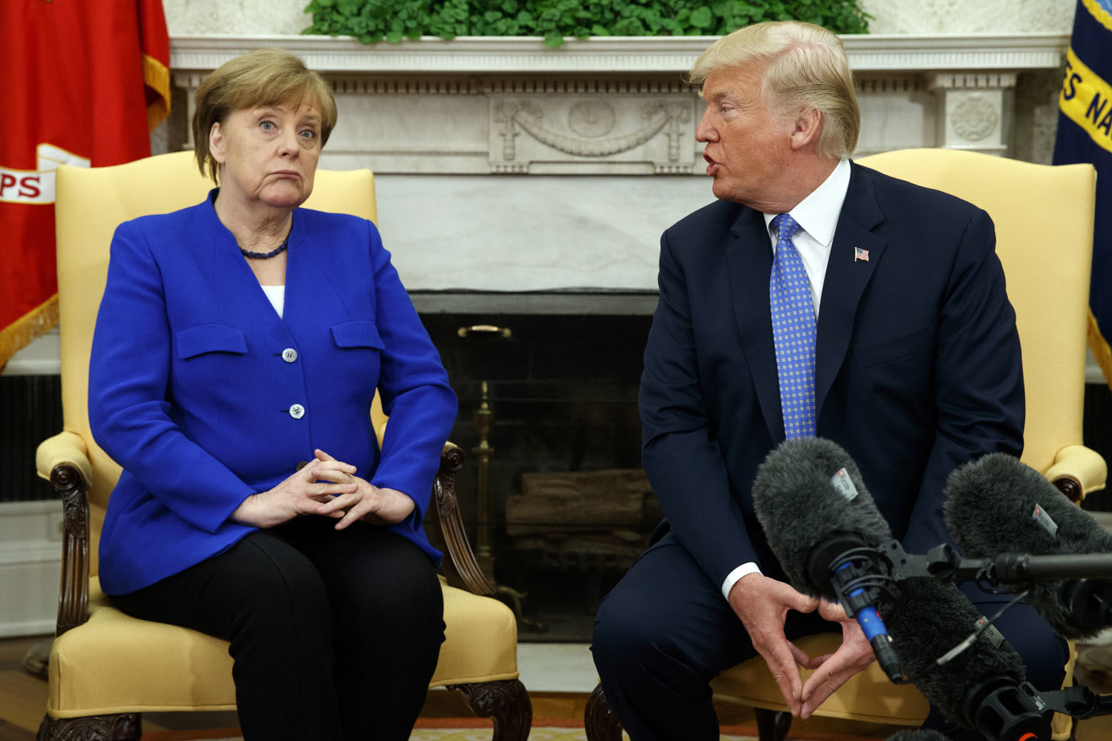 President Donald Trump meets with German Chancellor Angela Merkel in the Oval Office of the White House, Friday, April 27, 2018, in Washington. (AP Photo/Evan Vucci)
