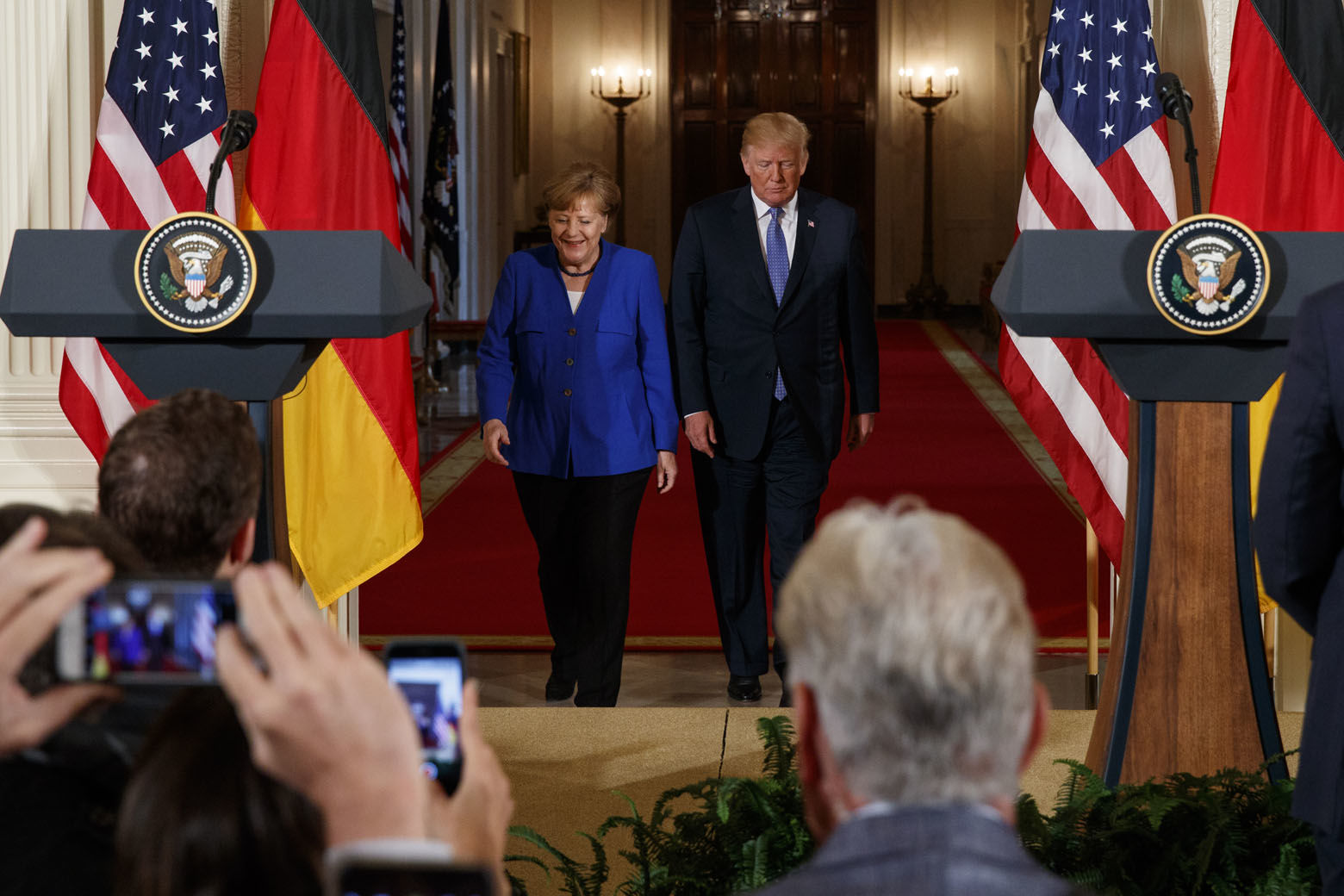 President Donald Trump and German Chancellor Angela Merkel arrive for a news conference in the East Room of the White House, Friday, April 27, 2018, in Washington. (AP Photo/Evan Vucci)