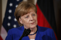German Chancellor Angela Merkel listens to a question during a news conference with President Donald Trump in the East Room of the White House, Friday, April 27, 2018, in Washington. (AP Photo/Evan Vucci)
