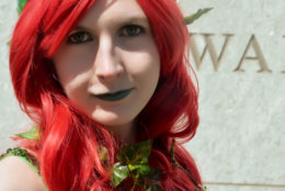 A woman dressed as the character Poison Ivy from the Batman comic book series and film arrives at Awesome Con 2018 at the Walter E. Washington Convention Center in Washington, D.C. (Shannon Finney)