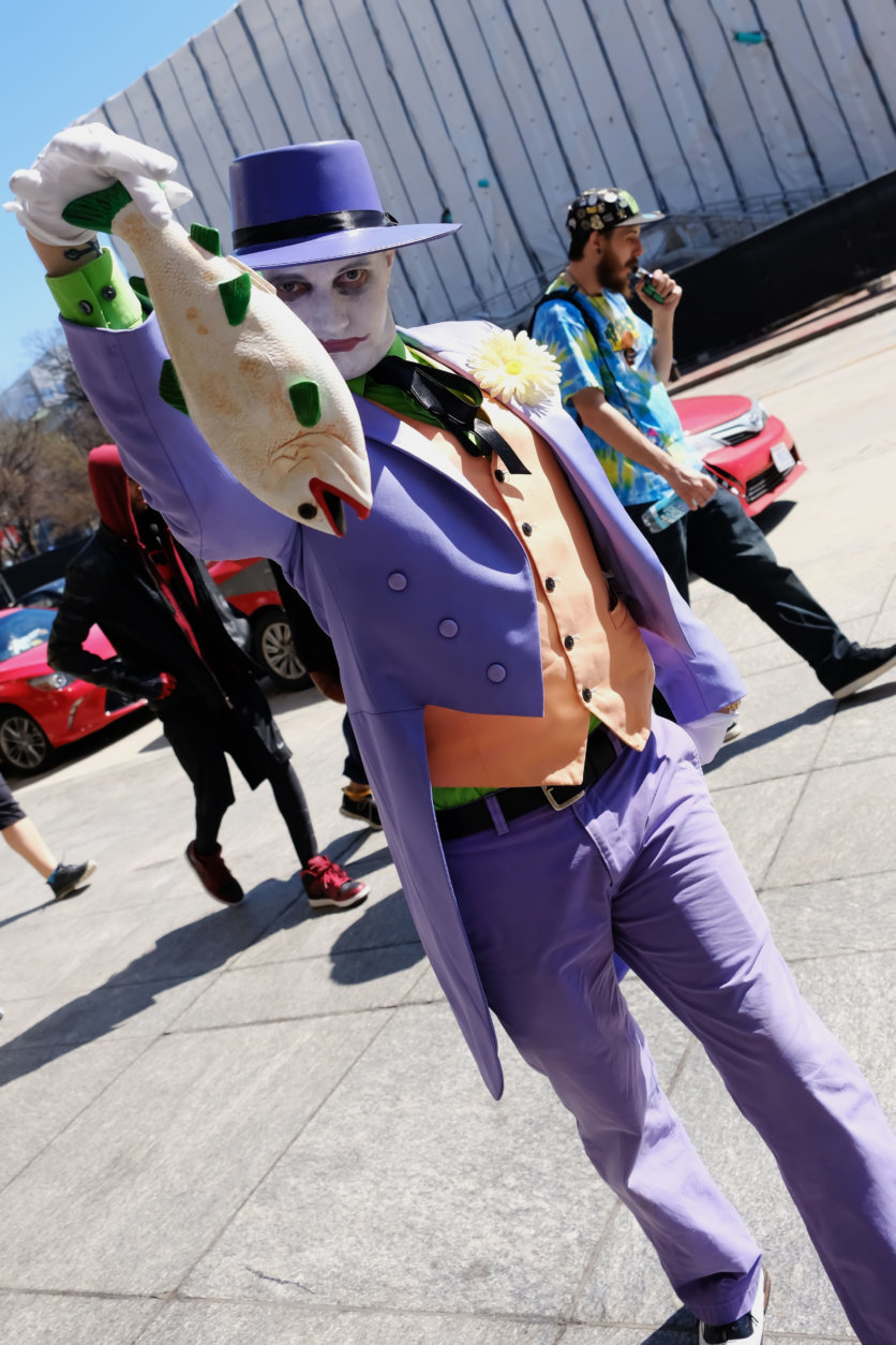 A man dressed as the character, The Joker, from the Batman comic book and movie series, arrives at Awesome Con 2018 at the Walter E. Washington Convention Center, Washington, D.C. (Shannon Finney)