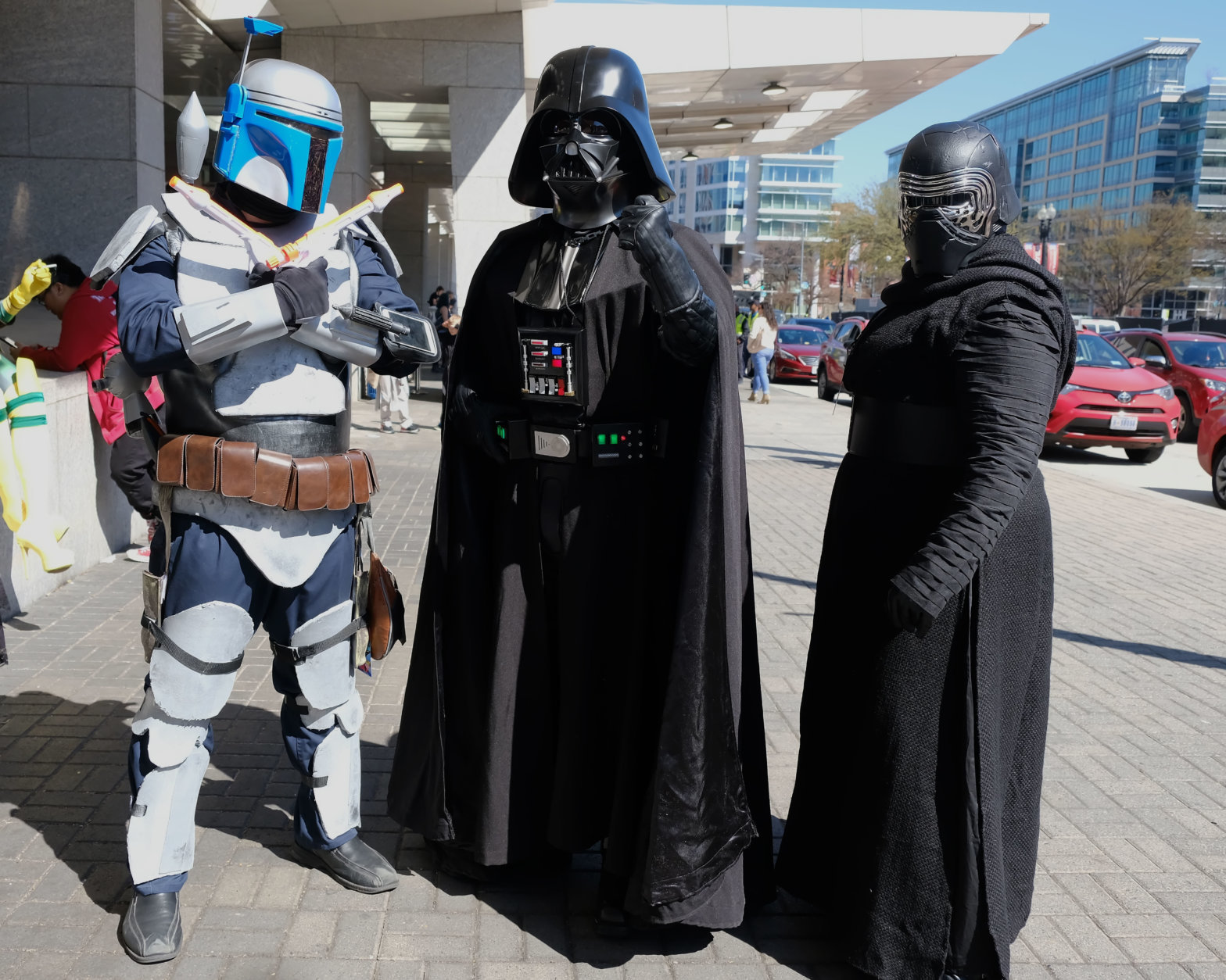 "Attendees dressed as Boba Fett, Darth Vader, and Kylo Ren from the ""Star Wars"" movie series arrive at AwesomeCon 2018 at the Walter E. Washington Convention Center in Washington, D.C. (Shannon Finney)"