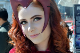 A woman dressed as the Scarlet Witch character from the Marvel Avengers comic book series and film arrives at Awesome Con 2018 at the Walter E. Washington Convention Center in Washington, D.C.