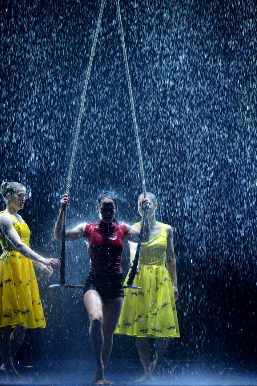 Acrobats rehearse their routine with a dramatic on-stage rainstorm. (Courtesy Shannon Finney)