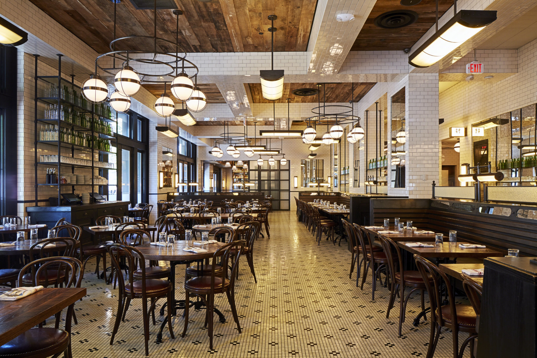 //3877's design of The Smith (901 F St. NW) sets black and white tile on the brasserie's floors against contrasting tile on the wall. (Courtesy //3877 ; Clarence Butts)