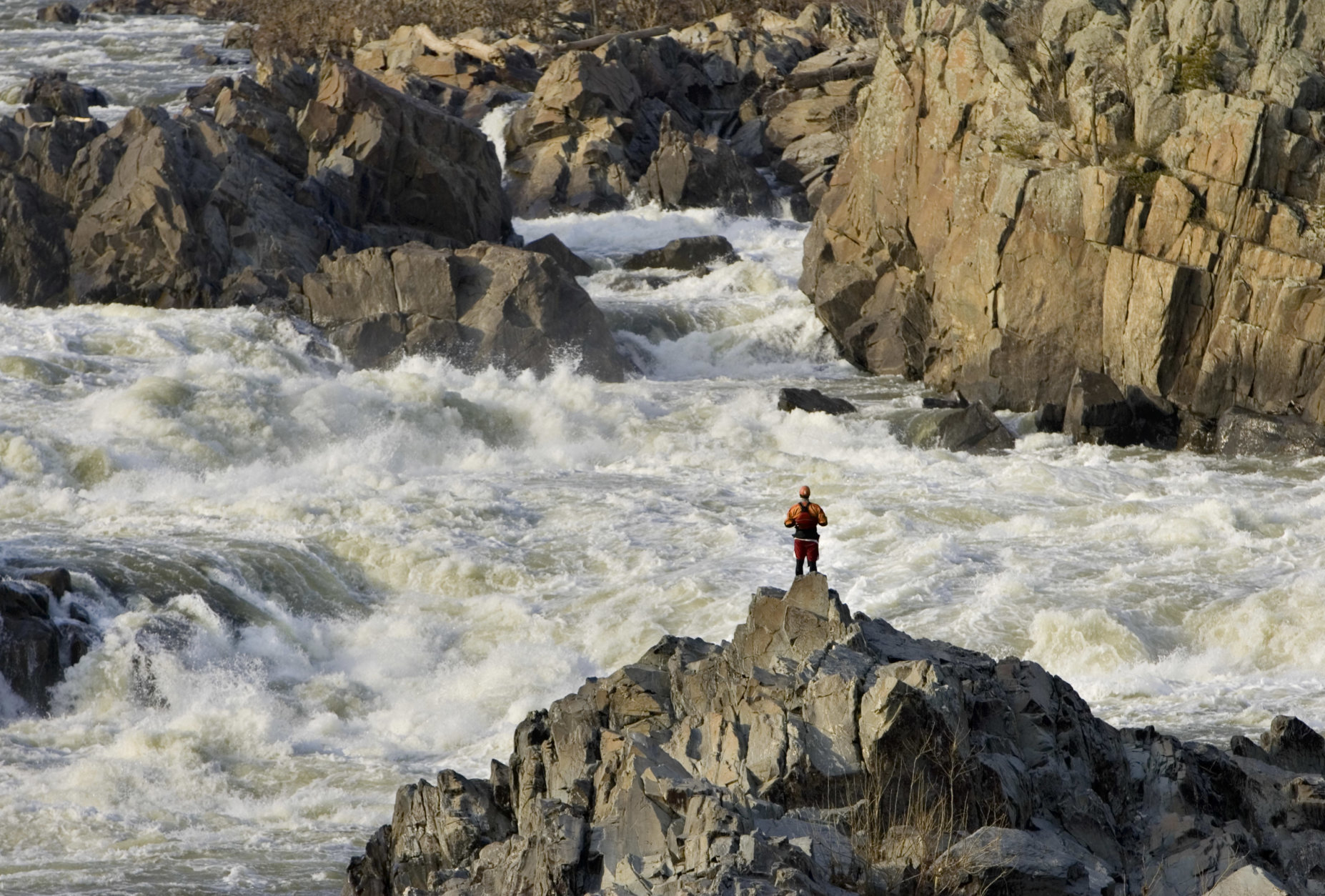 A kayaker enjoys the rushing waters of the  Potomac River at Great Falls, Va., near Washington, Tuesday, March 25, 2008. (AP  Photo/J. Scott Applewhite)