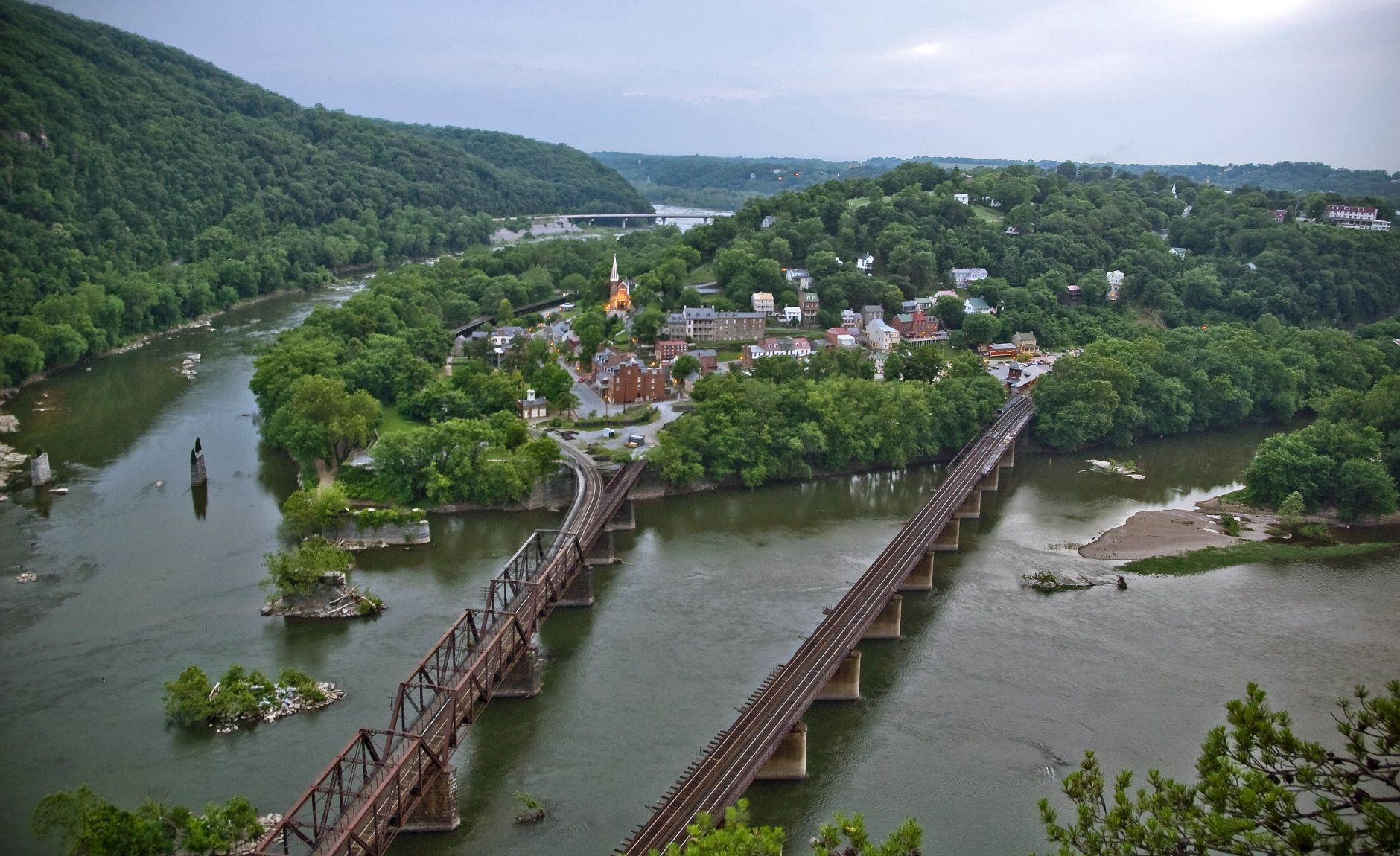 ** ADVANCE FOR WEEKEND EDITIONS, JUNE 13-14 ** FILE - This July 20, 2008 file photo offers a view looking down on Harpers Ferry, W.Va., at the conjunction of the Shanandoah, left, and the Potomac Rivers. The town was the site of abolitionist John Brown's infamous 1859 raid on the local arsenal, an event which led toward the Civil War. (AP/ Martin B. Cherry)
