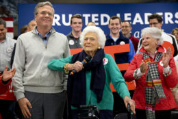 Barbara Bush, center, jokes with her son, Republican presidential candidate, former Florida Gov. Jeb Bush, while introducing him at a town hall meeting at West Running Brook Middle School in Derry, N.H., Thursday Feb. 4, 2016. (AP Photo/Jacquelyn Martin)