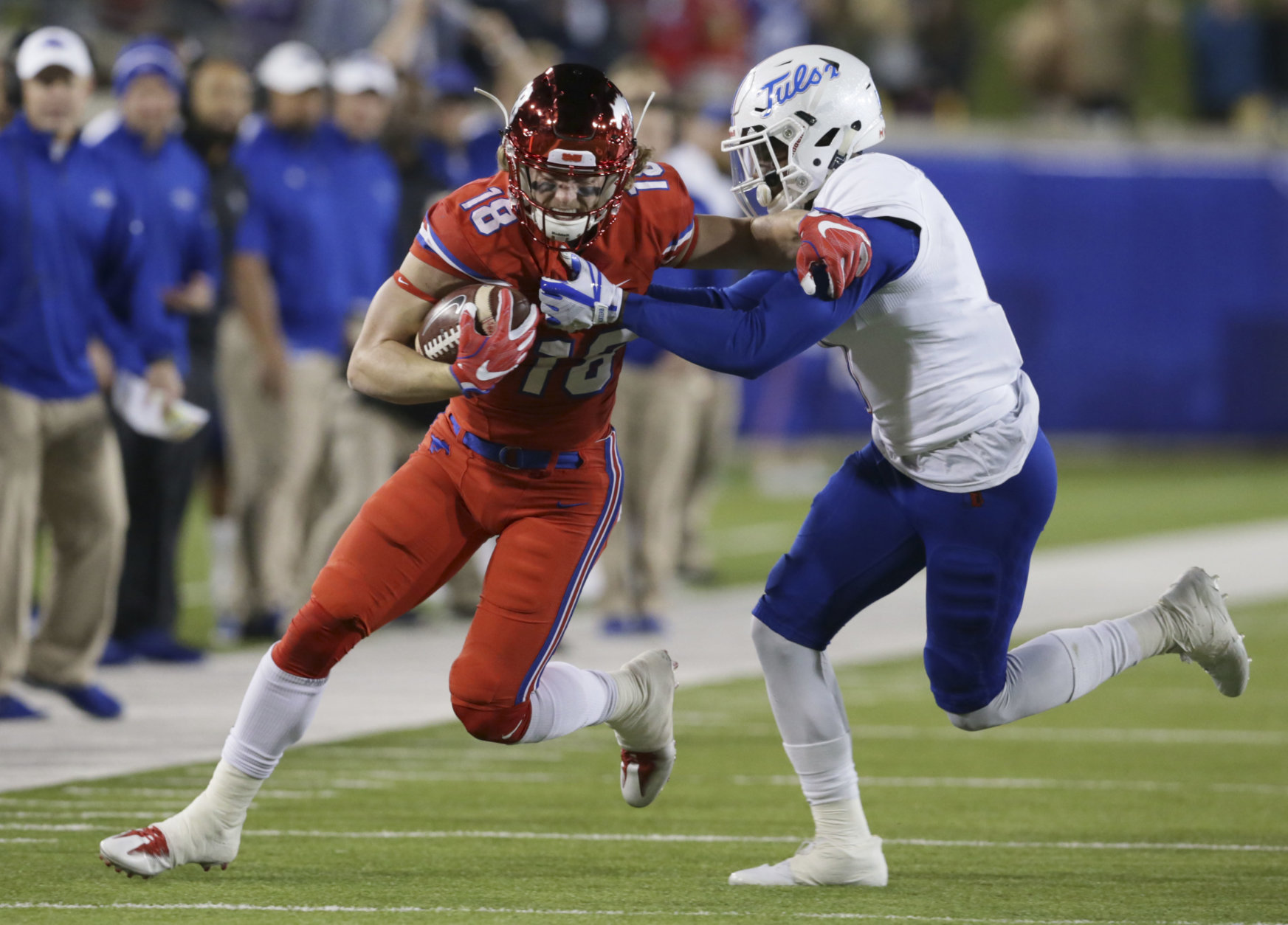 SMU wide receiver Trey Quinn (18) runs after the reception against Tulsa during the first half of an NCAA college football game in Dallas, Friday, Oct. 27, 2017. (AP Photo/LM Otero)