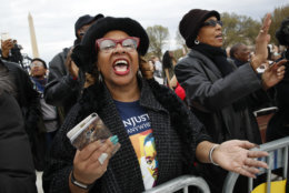 """Wearing a t-shirt of Martin Luther King, Jr., Debra Payne, of Kansas City, Missouri, sings """"This Little Light of Mine,"""" next to Jo-Lynn Gilliam, of East Point, Ga., as they attend the A.C.T. To End Racism rally, Wednesday, April 4, 2018, on the National Mall in Washington, on the 50th anniversary of Martin Luther King, Jr.'s assassination. (AP Photo/Jacquelyn Martin)"""