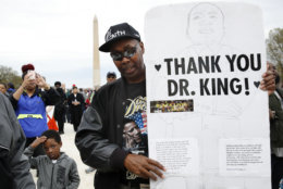 Leonard Patterson, of Manassas, Va., holds a hand made sign thanking Martin Luther King Jr., while attending the A.C.T. To End Racism rally, Wednesday, April 4, 2018, on the National Mall in Washington, on the 50th anniversary of King's assassination. (AP Photo/Jacquelyn Martin)