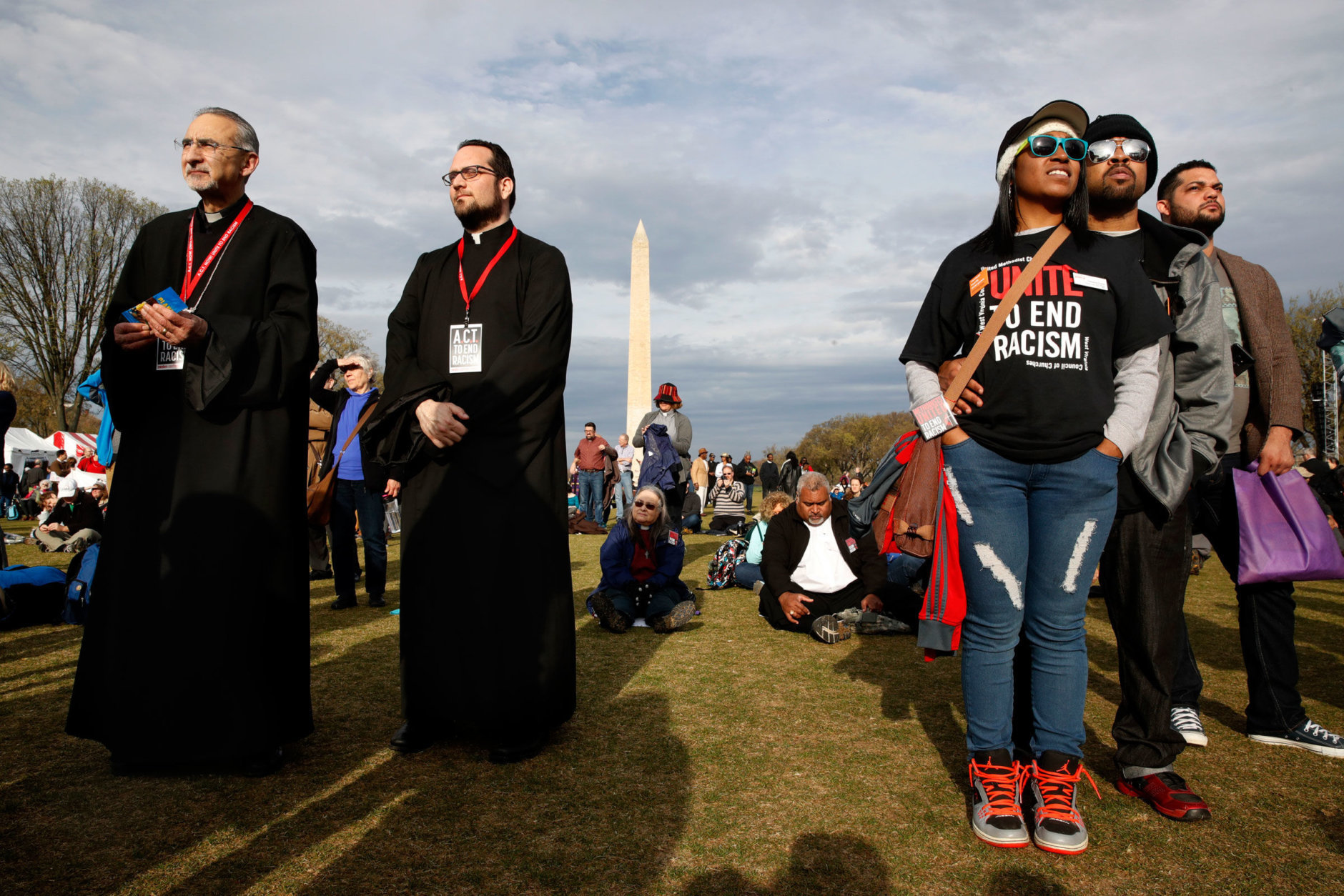 Father Yeprem Kelegian, left, and Father Avedis Kalayjian, both clergy in the Armenian Church, and Cheyanne Friend, center right, with her husband Darin Friend, of Charleston, W.V., attend the A.C.T. To End Racism rally, Wednesday, April 4, 2018, on the National Mall in Washington, on the 50th anniversary of Martin Luther King Jr.'s assassination. (AP Photo/Jacquelyn Martin)