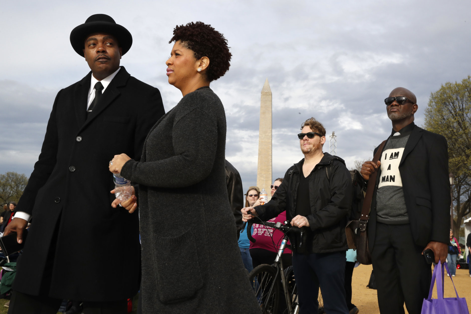 Milton A. Williams, left, pastor of Pennsylvania Ave. AME Zion Church in Baltimore, Ruth LaToison Ifill, with AME Zion Church, Stephen Marencic, of Washington, and Aaron Ward, of Washington, attend the A.C.T. To End Racism rally, Wednesday, April 4, 2018, on the National Mall in Washington, on the 50th anniversary of Martin Luther King Jr.'s assassination. (AP Photo/Jacquelyn Martin)