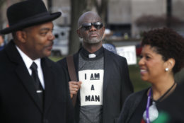 Aaron Ward, of Washington, center, attends the A.C.T. To End Racism rally, Wednesday, April 4, 2018, on the National Mall in Washington, on the 50th anniversary of Martin Luther King Jr.'s assassination. Milton A. Williams, left, pastor of Pennsylvania Ave. AME Zion Church in Baltimore and Ruth LaToison Ifill, with AME Zion Church, right. (AP Photo/Jacquelyn Martin)