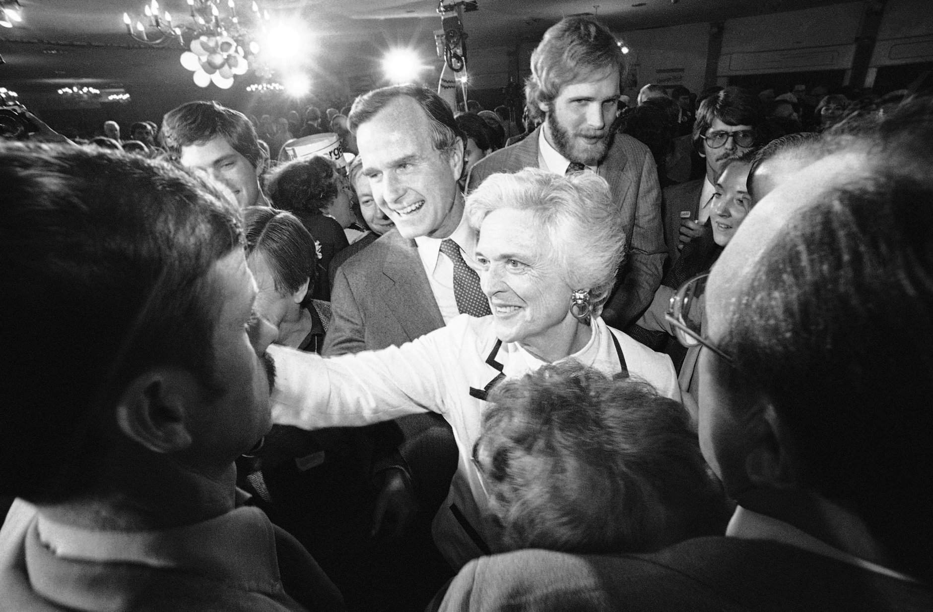 Former CIA director George Bush and his wife, Barbara, smile and shake hands with supporters as Bush left a Concord hotel ballroom after he spoke with supporters in Concord on Tuesday, Feb. 26, 1980. Bush, who was seeking the Republican presidential nomination, received 22 percent of the vote, while rival Ronald Reagan received 52 percent. (AP Photo)