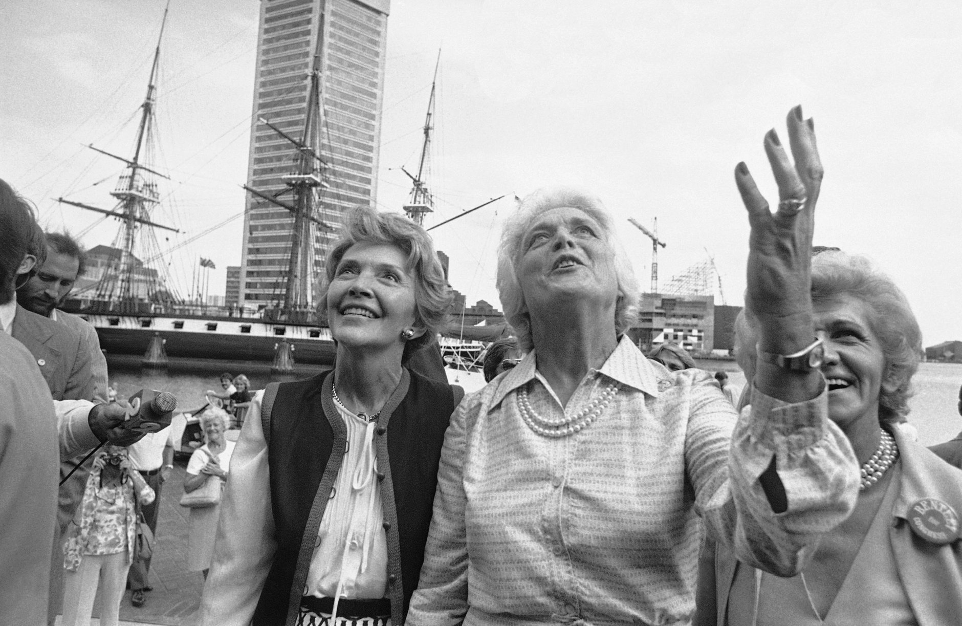 Nancy Reagan, left and Barbara Bush, right, wives of the GOP nominees for President and Vice President, plead to a crowd lining a balcony for their votes in this November's general election on Sept. 15, 1980 in Baltimore, Md.     The wives toured the Baltimore Inner Harbor while campaigning for their husbands. (AP Photo/William Smith)