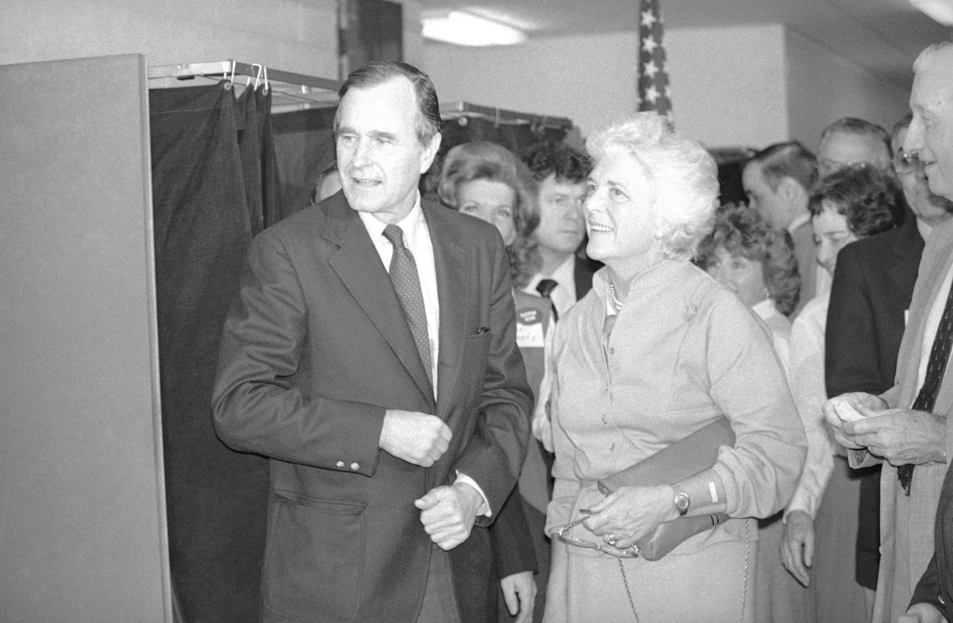 Republican vice-Presidential candidate and wife, Barbara are all smiles after casting their vote in the general election at their Houston precinct, Tuesday, Nov. 4, 1980. Bush was happy over the heavy turnout of voters at his precinct. (AP Photo)