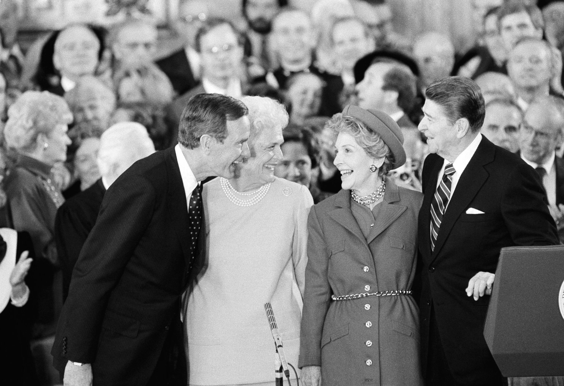 President and Mrs. Ronald Reagan, right, share a moment with Vice President and Mrs. George Bush following the oaths in the Capitol Building in Washington on Monday, Jan. 21, 1985. (AP Photo/Bob Daugherty)