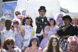 "Artist Sebastian Masuda, art director of NHK WORLD TV's Kawaii International, poses with fans costumed in Kawaii style in front of his ""Time After Time Capsule"" at the Sakura Matsuri Japanese Street Festival, a one-day cultural event held on Saturday, April 16, 2016 in Washington, D.C. NHK WORLD TV is a news and lifestyle channel produced fully in English and broadcast from Japan. (Kevin Wolf/AP Images for NHK WORLD)"