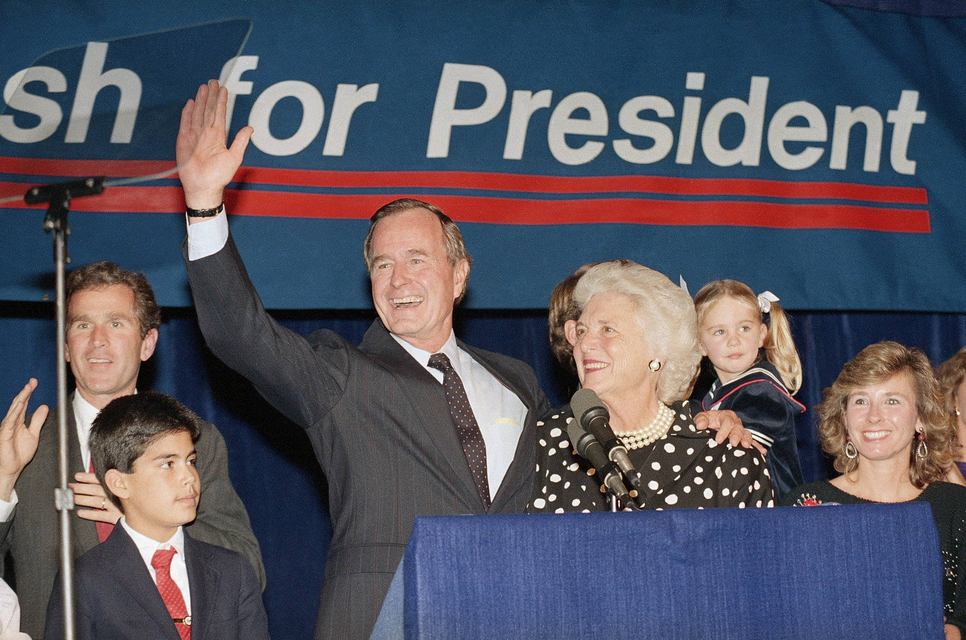 Vice President George Bush and wife, Barbara, wave to supporters that turned out in Houston, Texas, to hear him announce he was a candidate for the Republican nomination for president of the United States, Oct. 12, 1987.  (AP Photo/Ed Kolenovsky)