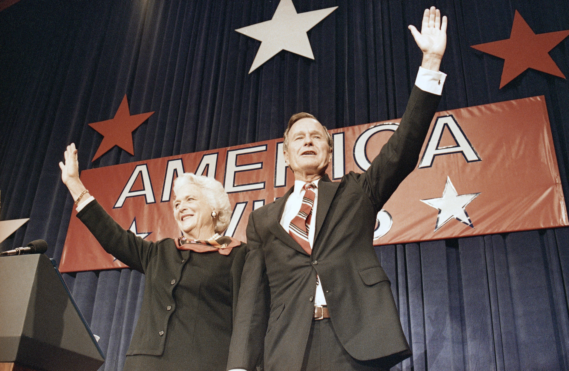 President-elect George H.W. Bush, right, and his wife Barbara Bush, wave to the crowd at a victory celebration rally, Tuesday, Nov. 8, 1988, Houston, Tex. (AP Photo/J. Scott Applewhite)