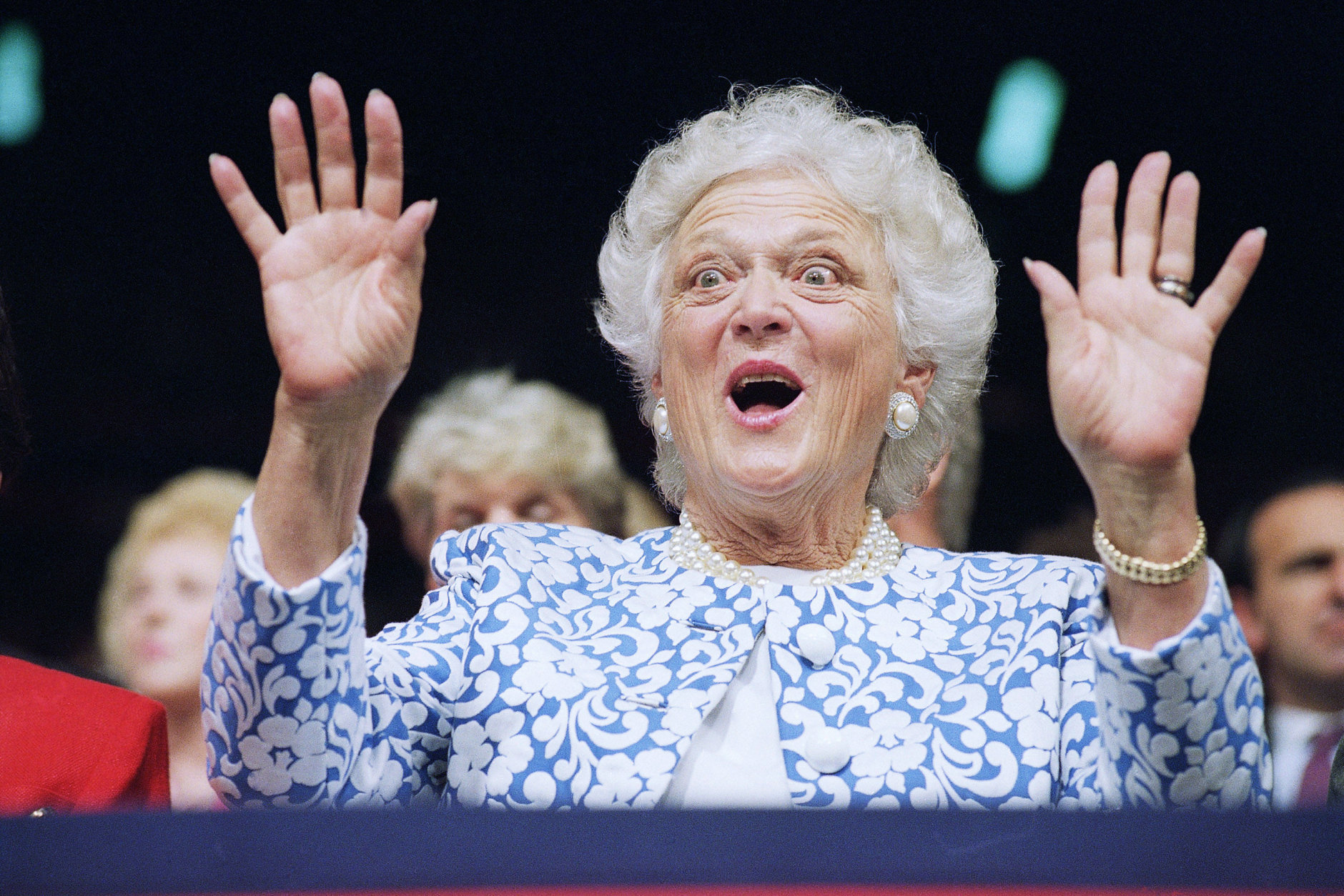 """First Lady Barbara Bush reacts to Sen. Phil Gramm, who delivered the keynote address to the Republican National Convention at the Houston Astrodome, Tuesday, Aug. 18, 1992, Houston, Tex. Gramm derided Democratic candidate Bill Clinton's economic program as a """"Lemon for America."""" (AP Photo/Marcy Nighswander)"""