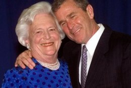 Texas Gov. George W. Bush, right, gives his mother, Barbara Bush , a hug after taking a family photo Thursday, June 10, 1999 in Houston. The Bush family gathered to celebrate former president George Bush and Barbara's birthdays. George Bush will turn 75 Saturday and Barbara turned 74 Tuesday. (AP Photo/David J. Phillip)