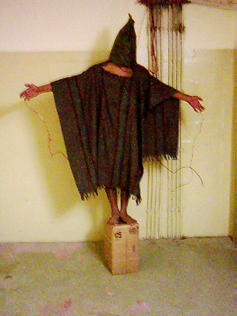 FILE - This late 2003 file image obtained by The Associated Press shows an unidentified detainee standing on a box with a bag on his head and wires attached to him, at the Abu Ghraib prison in Baghdad. (AP Photo, File)