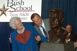 """FILE - In this Sept. 10, 1997 file photo, former President George Bush and his wife Barbara unveil a bust of the president during a ceremony to open The Bush School of Government and Public Service at Texas A&M University in College Station, Texas. Former first couple George and Barbara Bush's relationship is a true love story, described by granddaughter Jenna Bush Hager as """"remarkable."""" They met at a Christmas dance. She was 17. He was 18. Two years later they were married. Now 73 years later, with Barbara Bush declining further medical care for health problems, they are the longest-married couple in presidential history. (AP Photo/David J. Phillip)"""
