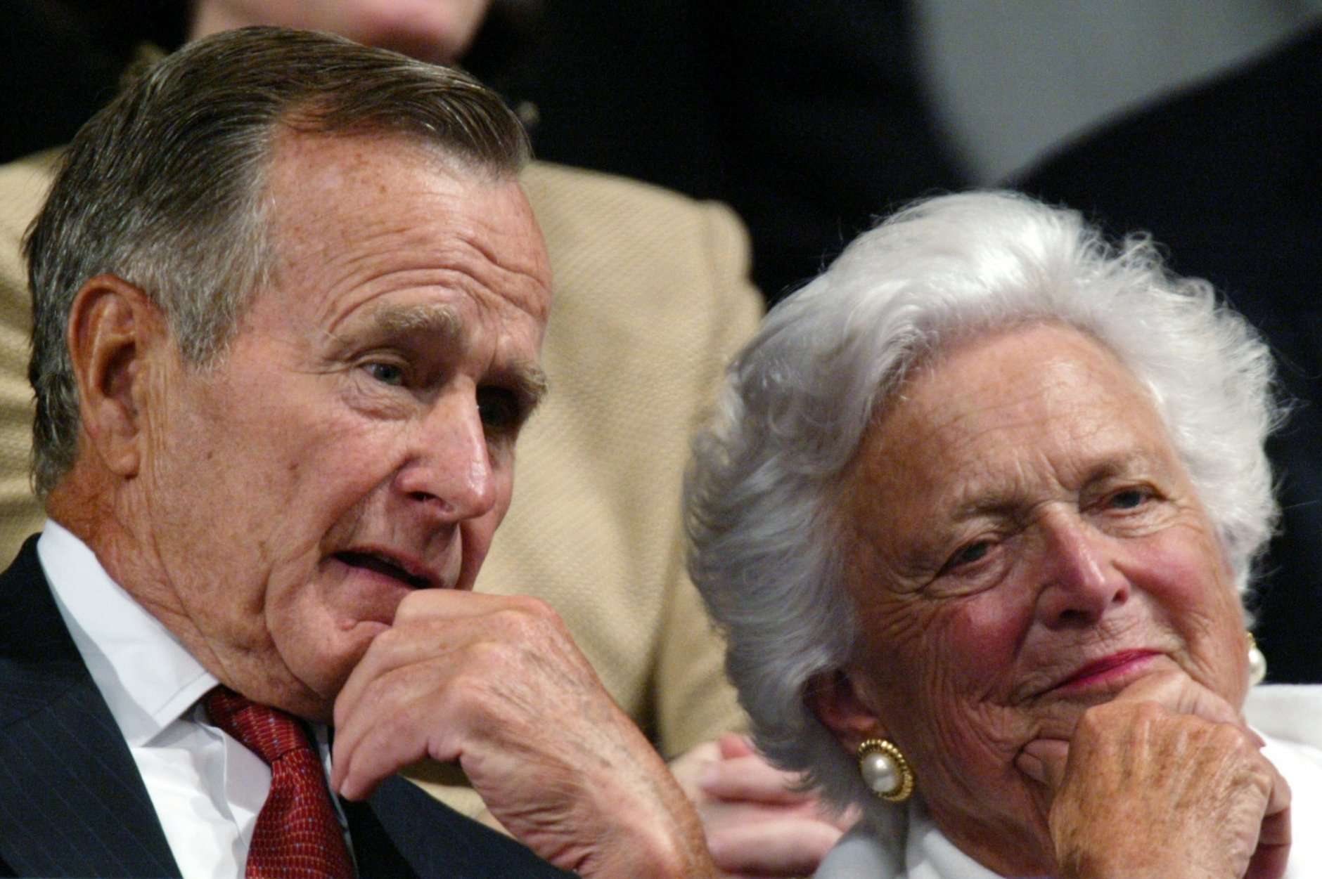 """FILE - In this Sept. 2, 2004, file photo, former President George H.W. Bush and former first lady Barbara Bush listen as the president accepts the party nomination at the Republican National Convention in New York. With her husband still at her side, Barbara Bush has decided to decline further medical treatment for health problems and focus instead on """"comfort care"""" at their home in Houston. Family spokesman Jim McGrath disclosed Barbara Bush's decision Sunday, April 15, 2018. (AP Photo/Paul Sancya, File)"""