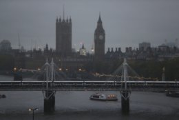 FILE - This Monday, Nov. 11, 2013 file photo, shows a view of central London's skyline by the river Thames. Hungerford Bridge, foreground, Big Ben's clock tower and Houses of Parliament, left. The Metropolitan Police said Monday April 2, 2018, the homicide rate in London has increased each month so far this year as the British capital suffers from an increase in knife-related crime. (AP Photo/Lefteris Pitarakis, File)