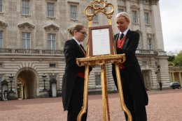 A notice is placed on an easel announcing the birth of the new Royal baby, in the forecourt of Buckingham Palace, in London, Monday, April 23, 2018. Kate, the Duchess of Cambridge gave birth Monday to a healthy baby boy — a third child for Kate and Prince William and fifth in line to the British throne. The palace said the baby prince was born at 11:01 a.m. (1001 GMT; 6:01 a.m. EDT) and weighed in at eight pounds, seven ounces (3.8 kilograms). (Pool Photo via AP)