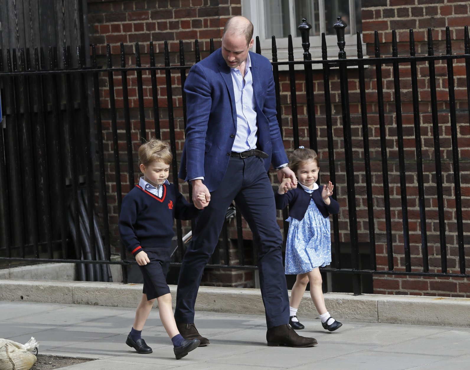 Britain's Prince William arrives with Prince George and Princess Charlotte back to the Lindo wing at St Mary's Hospital in London London, Monday, April 23, 2018. The Duchess of Cambridge gave birth Monday to a healthy baby boy — a third child for Kate and Prince William and fifth in line to the British throne. (AP Photo/Kirsty Wigglesworth)