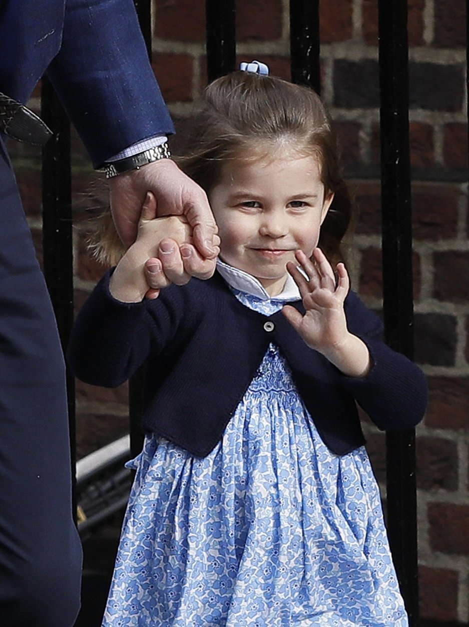 Britain's Prince William arrives with Princess Charlotte back to the Lindo wing at St Mary's Hospital in London London, Monday, April 23, 2018. The Duchess of Cambridge gave birth Monday to a healthy baby boy — a third child for Kate and Prince William and fifth in line to the British throne. (AP Photo/Kirsty Wigglesworth)