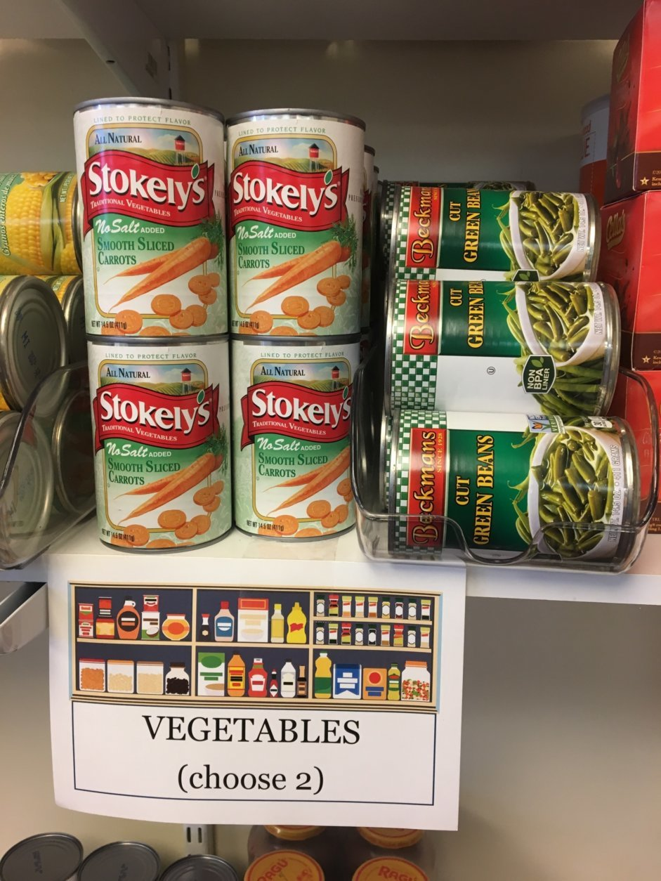 This March 14, 2018 photo shows canned goods at the campus food pantry of Schenectady County Community College in Schenectady, N.Y. New York is making free food pantries a standard fixture on all its public college campuses. It's part of efforts across the nation to deal with the ripple effect of rising college costs and changing student demographics that make it hard for some students to afford basics such as food. (AP Photo/Mary Esch)