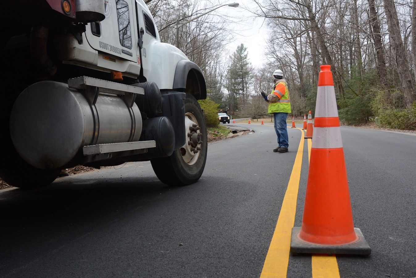 Work zone awareness week strives to get drivers to slow down when approaching crews like this one along Stuart Mill Road. (WTOP/Dave Dildine)