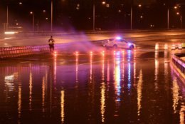 Early Monday morning the I-66 WB  was diverted off Roosevelt Bridge toward US-50 or NB GW Pkwy due to flooding in Arlington. Now getting by without major problems. (WTOP/Dave Dildine)