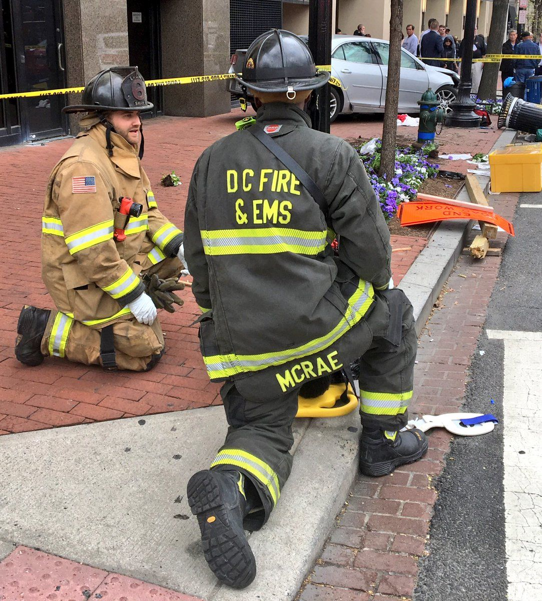 Several pedestrians are injured after a car jumped the curb and drove onto the sidewalk following a crash in downtown D.C. Tuesday. (Courtesy DC Fire and EMS)