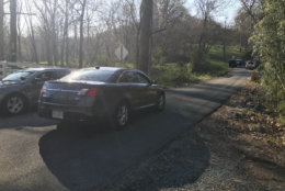 Detectives with the Fairfax County Police Department on the scene of an apparent homicide on Cochester Road. (Courtesy Fairfax County Police Department via Twitter)