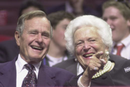 374784 02: ,George and Barbara Bush point to well-wishers during the first day of the Republican National Convention, July 31, 2000 in Philadelphia. (Photo by Chris Hondros/Newsmakers)