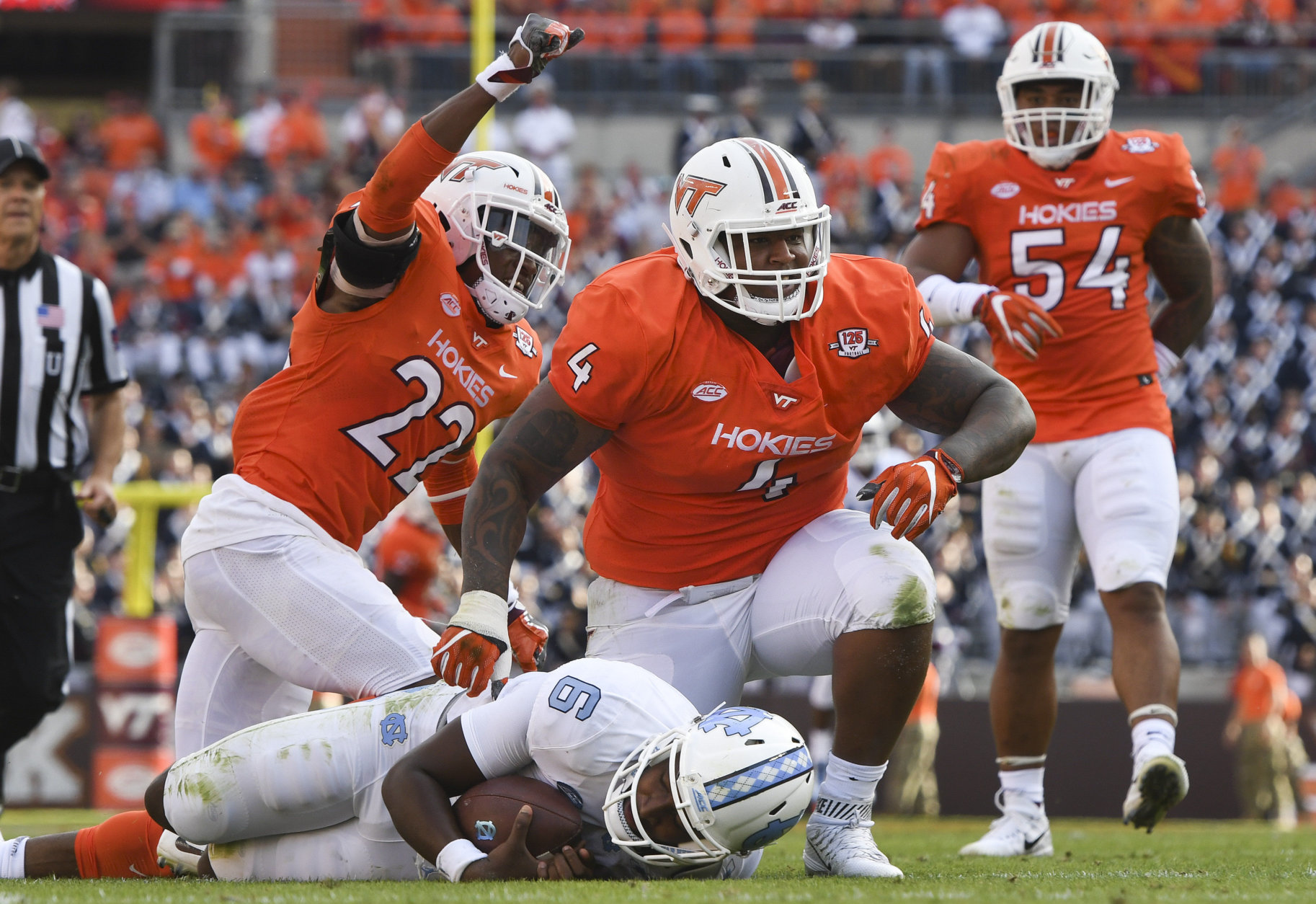 BLACKSBURG, VA - OCTOBER 21: Defensive tackle Tim Settle #4 and safety Terrell Edmunds #22 of the Virginia Tech Hokies celebrate their sack on quarterback Brandon Harris #6 of the North Carolina Tar Heels in the first half at Lane Stadium on October 21, 2017 in Blacksburg, Virginia. (Photo by Michael Shroyer/Getty Images)
