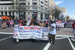 The D.C. Emancipation Day parade marches along in the downtown area on Saturday, April 14, 2018.  (WTOP/Dick Uliano)