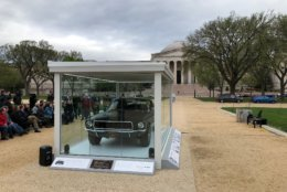 """Gessler called the glass-walled display between the National Air and Space Museum and the National Gallery of Art """"the world's smallest car museum."""" (WTOP/John Aaron)"""